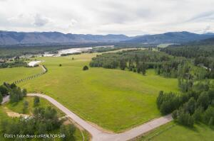 Discover this exceptional offering off of Fall Creek Road.  With approximately 22 acres comprised of two parcels, lots 64 and 65 of Rivermeadows, this building site is a rare opportunity to secure a wonderful setting for your dream home in a quiet, bucolic part of the Jackson Hole valley. With beautiful Grand Teton views, and views of the Snake River, the property features wide open grassy meadows and a pleasant mix of aspen and evergreens.  Enjoy gently rolling terrain, a sense of space and a private location.  Less than 15 minutes from Wilson, the property is easily accessible year round.