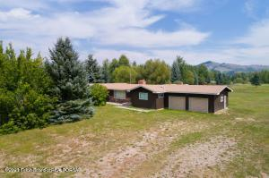 Ideally situated across from Teton Pines, this rare 2-acre horse-friendly property on the West Bank is a dream location for the avid recreationist who appreciates easy access to the Jackson Hole Mountain Resort, Grand Teton National Park, Snake River & Teton Pass. A 1,750 sq ft home features 2 bedrooms, 2 baths, 2-car attached garage. The property is flat and zoned neighborhood conservation. Imagine your dream home & guest house or additional permitted income property on this coveted West Bank property. Enjoy views of the entire Teton range, the Tram at the Jackson Hole Mountain Resort with all its peaks and slopes, convenient all access to the valley's amenities including the West Bank recreational pathway connecting the entire Jackson Hole valley. Property is visited by abundant wildlife