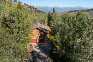 Nestled in a mature aspen grove in the saddle of East Gros Ventre Butte, known as Saddle Butte, sits a nicely appointed cabin ready for a new owner. The privacy of this cabin is unmatched, considering the 1.87 acre parcel is only 5 minutes from the Town Square of Jackson Hole. The cabin's peaceful deck looks out towards the Teton Range and shaded by mature White Pines filled with wildlife. The lot is very usable and could be improved upon with another structure.