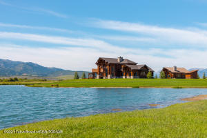 Stonefly Ranch is a premiere luxury fly fishing retreat located in beautiful Star Valley 12 minutes from the Snake River Canyon.This exceptional luxury ranch boasts six acres of fully-stocked, 20-foot-deep ponds loaded with 30-inch native cutthroat and has 3/4 of a mile of both sides of the Salt River. The river has many unique characteristics and attributes not found anywhere in Star Valley. This handcrafted stunning lodge compound offers an abundance of fishing opportunities along with other recreational options like hunting, golfing, shooting, canoeing, snow shoeing, snowmobiling, etc. The abundance of wildlife on this property is spectacular and truly makes this retreat an amazing outdoor private paradise. Stonefly Ranch is destination living at its finest and perfect for the... discerning couple or family who want peace, quiet and security in a spectacular location.  This 79.30 acre hidden gem is an end-of-the-road property and once you pass the gate, it is truly perfect for the discriminating outdoorsman. The property is meticulously landscaped, 100 percent usable and functional, easy to maintain but offers privacy and serenity while being close enough to amenities for ease of living. The views of The Salt River Range and The Wyoming Range are extraordinary, and no matter where one looks, they'll be enamored with the attention to detail and class that exists overall on this entire 79.30 acre spread. There is an abundance of water on this property with excellent water rights. This rural estate also provides income from hay production and a crop-share grazing option giving the property an ag tax exemption.  The magnificent handcrafted 3463 square foot new home situated near the river with unobstructed 360 degree mountain views is well appointed with many upgrades and is a true gentleman's refuge. This luxury smart home built with strict attention to detail and the 816 square foot luxury guest cabin are perfect for individuals who desire privacy and solitude but 