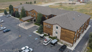 This 100 room all-suite hotel offers an established turnkey lodging operation in the greater Jackson Hole region. With incredible access to the Wind River Range, the bustling mountain destination of Pinedale, Wyoming is the perfect setting for a growing tourism economy. With full commercial zoning, the structure and land allow maximum flexibility in use, creating a variety of opportunities for a new owner. Located within walking distance to many of Pinedale's best downtown attractions, the hotel is ideal for those visiting the area a few nights or those needing longer term stays for work or leisure. Thoughtfully designed, the hotel includes several amenities such as a breakfast room, meeting area, guest laundry, workout room, full housekeeping facilities on site and a welcoming lobby. The hotel is three stories and has elevator access. As Pinedale's only all-suite hotel, short and long term guests can make themselves at home with fully equipped rooms including ovens and cookware.   In continuous operation since 2006, the High Country Suites has demonstrated multiple business models for revenue, including long-term stays leased with national oil companies and nightly stays boosted by growing tourism in the area. The well-built hotel has been maintained over the years with updates to furniture and appliances and a commitment to keeping rooms clean and inviting for those spending just a few nights or several months.
