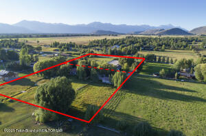 Sunny South Park Ranch is a rare combined 5-acre property providing country life just minutes from downtown Jackson Hole. Nestled in a quiet area of the Valley away from the hustle and bustle, this special Ranch property is seldom found in that it encompasses two separately deeded 2.5 acre lots, and allows for the option to sell off one of the parcels if you choose. Rich in authenticity and full of Wyoming charm this property offers endless possibilities, and with no CC&Rs, allows for flexibility in accomplishing a vision of your own. South Park Ranch transports you back to quieter times with friends, family, animals, horses, toys - whatever your heart desires. At the end of the cul-de-sac with pastoral views of the Tetons and Munger Mountain ,this lush and private property affords a pleas ing 5-bedroom main home, sophisticated horse facilities, oversized 3-car garage and an additional ample storage shed, as well as mature landscaping, irrigated pastures, a stream, pond and water rights. Just a few minutes' drive to the amenities of town, schools, shopping, groceries, restaurants and 3 Creek Ranch