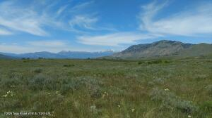Rare offering of elevated 360-degree  mountain views of the Snake River Valley in Jackson. This 12+ acre building site is the perfect horse property with a flat terrain and amazing views of Munger Mountain, Glory Bowl and Teton Pass. This is a one-of-a-kind opportunity to to own property nestled between Teton National Forest, Jackson Hole Land Trust and Wyoming Game and Fish land.