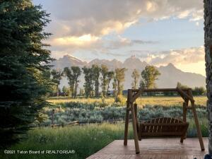 Step into tranquility north of town while taking in the sweeping Teton views. Situated on just over an acre of land and adjacent to 147+ acres of protected open space gives the feel of your own private Jackson Hole Ranch. This 5,000+ square foot home boasts an open floor plan, all en-suite bedrooms, an expansive garage and a gracious great room. The spacious back decks provide front row seats to world class wildlife viewing while being moments from the foot of the Tetons. The layout lends itself to separation for guests from the main living area with their own private space. Beautiful fir wood floors paired with wood finishes throughout gives the home a mountain feel. Located 15 minutes from the town of Jackson and just minutes from Grand Teton National Park, this location cannot be beat.