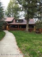 Quintessential Cabin in the woods. Located in Moran and bordering the National Forest, you are minutes away from Grand Teton National Park and the entrance to Yellowstone. The cabin has three bedrooms and two bathrooms, a small office and a  wood burning fireplace. There is also a guest apartment for overflow guests or a caretaker/renter.