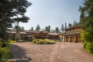 Comprised of 10,242 livable square feet, this Wilson estate is in the heart of Crescent H, surrounded by nature with Teton views and access to miles of National Forest. Immaculately built with impeccable attention to detail, this property is a truly unique Jackson Hole masterpiece. Impressive main home with attached garage with upstairs apartment and separate guest home with garage provide three separate living spaces for visiting family or guests. Access the world class amenities of Crescent H--including private fly fishing and hiking and running trails in some of the most sought after land in Teton County.