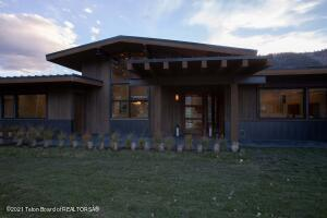 Modern Mountain Home at the Snake River Sporting Club.  This under construction home is on the 3rd hole of the Tom Weiskopf designed golf course.  Sweeping mountain views from a large open concept living area.