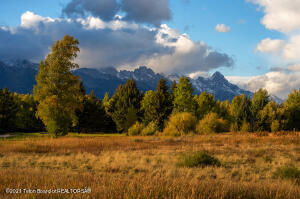This beautiful golf course lot in Jackson boasts amazing Grand Teton and Sleeping Indian views. Located on the prestigious Jackson Hole Golf and Tennis Club, it is about 10 minutes north of downtown Jackson and close to Grand Teton National Park. Seasonal stream, ''Water Easement'' on the North end of the property. It is the perfect spot to build your home on one of the best streets while enjoying the incredible sweeping views of the Tetons and the Sleeping Indian.