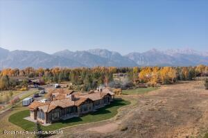 With direct mountain views of both the Grand Teton and the Sleeping Indian, this 1.06 acre lot within the Jackson Hole Golf and Tennis resort has a beautifully crafted new home for the discerning buyer. Situated on a quiet cul-de-sac, this home has been constructed with thoughtful details in every room. Vaulted ceilings meet with large windows in the great room drawing in the natural sunlight.  A generous chef's kitchen with Sub-Zero, Wolf and Cove appliances are at your fingertips to create the perfect meal. Just off the kitchen is the custom Wolf bar-b-que, protected from the weather to provide year-round use.  The private Master Suite high-lights an array of custom features including a ceiling with contrasting beams and paneling, a gas fireplace, and walk-in closet. A guest wing with 2 more bedrooms, each en-suite, welcome your guests in comfort and privacy. In each bathroom, mosaic tiles and custom cabinetry were carefully selected to blend function with beauty.   Located about 10 minutes north of the Town of Jackson, this home is close to Grand Teton National Park and a short drive to Yellowstone National Park. Skiing, hiking, biking, fishing, climbing and more are only a few of the outdoor activities easily accessible.