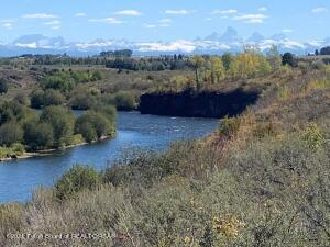 Located near downtown Ashton, Idaho this operational farm provides a 1/4 mile of frontage on the famed Henry's Fork River.  Build your western retreat dream home on the banks of this world class fishery with Grand Teton Views in the distance.  Farm production on the ranch includes 193 tillable acres irrigated primarily by 3 half-washer center pivots.  These pivots will transfer with the sale of the ranch.  A current Farm Lease was signed in 2021 which extends through 2026 at a rate of $160/irrigated acre or $30,000 annually.  Call broker for details.