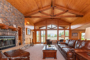 Simple and clean line elegance paired with breathtaking views define this mountain style home situated on 3+ beautiful acres in BBB Meadows. Cathedral windows in the great room capture your attention from the moment you step foot inside framing the Teton views. Sitting out on the back patio, you will find yourself encompassed by the serenity and openness of this lot . The gourmet and generous kitchen open up to the great room making the space perfect for entertaining. With 3 bedrooms and 2 baths currently, the home has the opportunity to be expanded creating more living space or enjoy the easy turn key layout as is in this ideal Jackson Hole home. Wildlife abound in this subdivision with permanent open space throughout. Owners can also enjoy cross county skiing in the winter. A must see!