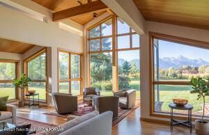 This 6-acre estate is one of the finest locations in all of Jackson Hole. From the dramatic Teton views and beautifully manicured gardens, you feel as though you have come to a special one-of-a-kind place as you enter. Located on two premier lots in Fairway Estates, this single-story mountain contemporary home has over 15,000 square feet of improvements. The main house has four spacious bedrooms, all en-suite, including a master bedroom suite, fit for royalty. In addition, there is a media room and an executive office as well as an expansive kitchen perfect for any inspired chef.   The entire estate has soaring vaulted ceilings, with all inlaid tongue and groove clear fir paneling meticulously handcrafted for the home. The 2,000-bottle wine cellar is accessed through an underground passageway that connects the main house with the annex. The annex includes a complete guest house with three bedrooms and plenty of room for your guests to cook and enjoy themselves.  The indoor swimming pool is complete with heated floors and a spacious gym. And finally, the office annex is a private wing with Mahogany walls, walnut floors, and a perfectly framed view of The Grand Tetons. Live the mountain lifestyle by relaxing on one of the many patios or spend the evening cooking smores at the fire pit and watching the stars light up the evening sky.    MORE PICTURES COMING SOON
