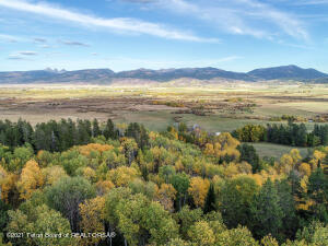 This wild and beautifully wooded, 251.8-acre parcel on the south-west end of Teton Valley, is nestled between Grove Creek and Drake Creek in the foothills of the Big Hole Mountains, bordering the Caribou-Targhee National Forest for over one-mile and is just 4.5 miles from downtown Victor, ID. The terrain consists of elevated north-facing forested hillsides and open south-facing parks, with sweeping views of the Teton Range and of the Grand Teton. The property is an easy drive to some of the best fly-fishing and skiing in the world and has out the door access to world class biking, hiking, snowmobiling and hunting. This untouched property would make a perfect private retreat.