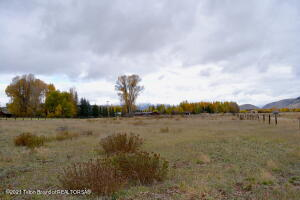 Special opportunity to own a 3-acre building site in the ''Banana Belt'' of Jackson Hole. Located on the southern portion of South Park Loop Road, the property has HUGE 360-degree views including the Grand Teton and the entire Teton range, High School Butte, Snow King Mtn., Munger Mtn. and the Snake River Range. Fenced and flat, with no CC&Rs (covenants or restrictions), this is a great property for horse enthusiast and is adjacent to the Teton County Bike Path system. Close proximity to town, Snake River access, fishing, hiking, horseback riding and everything else the Jackson Hole Lifestyle has to offer! Don't miss this opportunity to create a legacy retreat with no restrictions. You can build up to an 8,000 sf. home, 1,000 sf. guest house and a 1,000 sf. accessory/barn/garage.