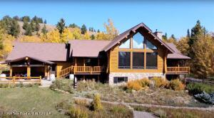 Contemporary western log home built in 2000 with hand peeled Canadian spruce logs, no joints. Secluded community with spectacular views. 4 miles to Grand Teton National Park. 4300 square feet of livable space on 3 levels with an attached 862 square foot double garage. 4 bedrooms, 4 baths, & two half baths. Main floor has all essential living needs with newer appliances in the large kitchen. Vaulted ceilings throughout the main floor Downstairs designed as separate living quarters with two bedrooms 2 bath and a half bath. Including a full kitchen, game, exercise and laundry area. Quick access to the Parks and the Continential Divide.All of this only 45 minutes from the Jackson town square.