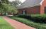 Norht side of home with wrap around inlaid brick sidewalk
