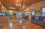 Open floor plan with vaulted ceiling.