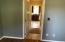 First floor bedroom is off kitchen hall