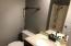 Full three piece bath off kitchen to bedroom hall