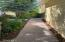 Paver brick walkway from gate to rear of house