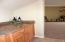 Located between the kitchen and dining room, granite counters.