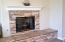Stacked-stone fireplace with raised hearth