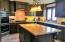 Granite countertops, Viking Refrigerator and separate Viking Freezer.