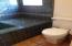 Master bathroom with custom tiles