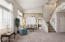 Living room and formal dining room with beautiful murals, high ceilings