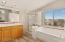 Huge master bath, tub, shower private toilet, dual sink areas, abundant storage.