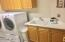 Large inside laundry room opens to garage. Washer and Dryer included