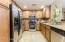 Chef's kitchen with stainless steel appliances.