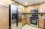 Kitchen has granite counters.