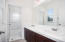 Secondary Bathroom with Dual sinks and Tub/Shower enclosure