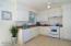 Cheery and bright kitchen.