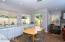 Garber roller shades and vertical panel window coverings. Wood-look, wide plank porcelain tile flooring