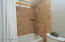 """Kohler """"Archer"""" bathtub, sinks and toilet. Hansgrohe crome sink faucets, thermostatic bathtub faucets & shower heads and Porcelain tile floor"""