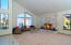 Extremely spacious Living Room with vaulted ceilings, ample natural light, and fireplace.