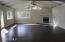 Gigantic games/party room with vaulted ceiling and walk out to back yard. Gas fireplace.