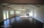 Large games/party room. Gas fireplace, new floors, new fixtures and windows.