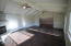 Large games/ party room with vaulted ceilings.