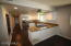Eat in kitchen with new appliances and kitchen cupboards and lighting.