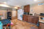 Downstairs unit kitchen- huge income potential! Private entrance & parking.