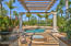Soaring ceilings, stunning entertainment vignettes, and an incredible outdoor entertainment area, showcasing a spectacular pool and spa, with detached pool loggia that provides rear yard entertainment and outdoor kitchen area with ornamental fan. The magnificence of the rear grounds is nothing short of amazing. Completely private and serene it offers a variety of distinctive and separate areas to enjoy a vacation-like escape.
