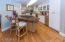 Updated kitchen with front island with butcher block counter top & bar. gas stove top