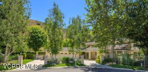 Positioned at the end of a small cul-de-sac is this custom estate that is surrounded by greenery and hills.