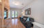 Play room/Den/Office with custom built -ins & french doors leafing to the exterior
