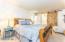 Downstairs Master Bedroom with Custom Built Barn Door to Bathroom