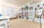 Bedroom #3, custom built in Bookshelves with rolling ladder
