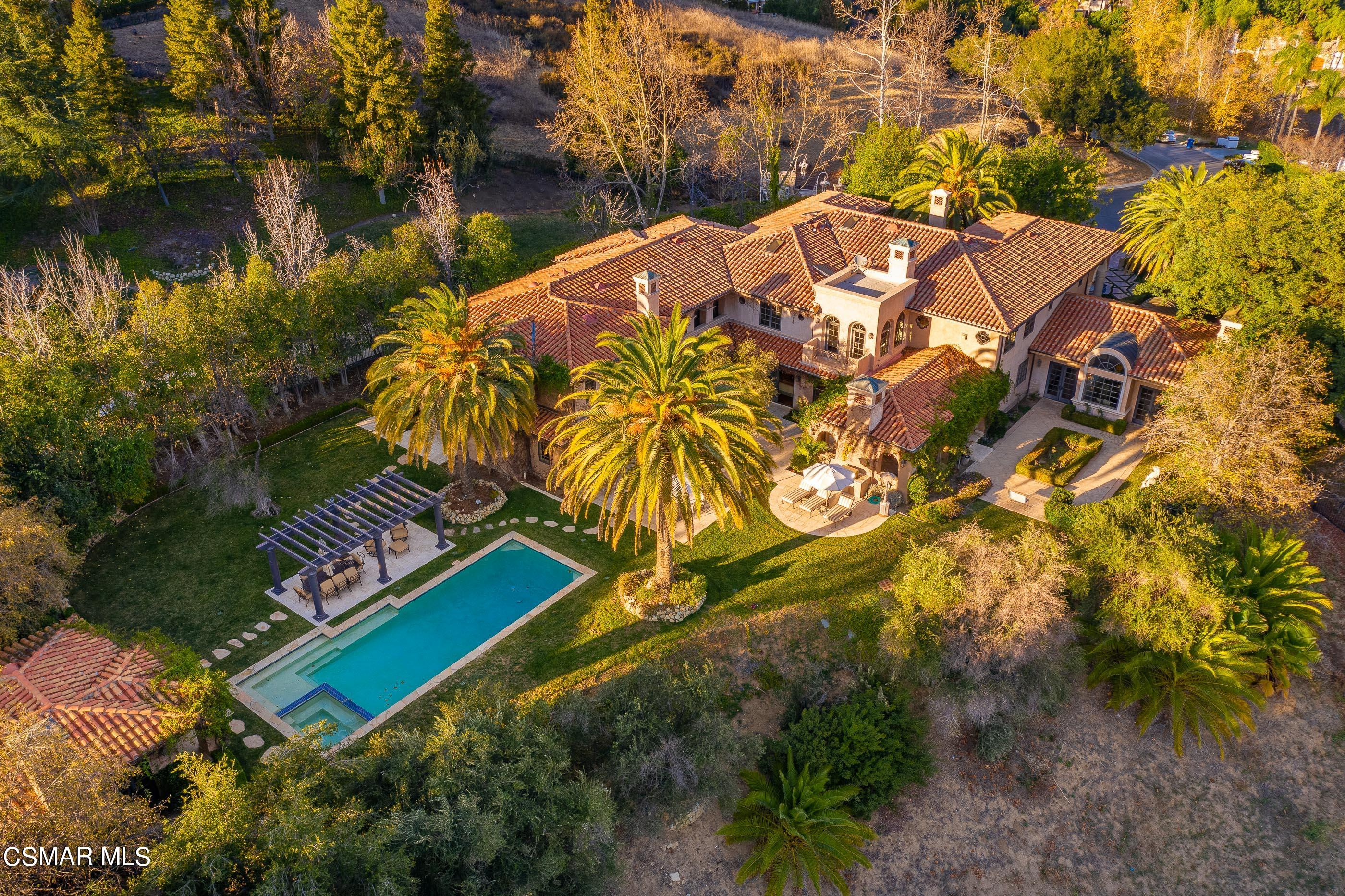 Set upon an approx. 1.5-acre cul-de-sac lot, this Grand Italian Villa is one of the premier estates in Westlake Village! Custom-crafted and designed for entertainment on an epic scale, this Country Club Estates European masterpiece showcases incredible mountain views and affords the utmost in privacy. This approx. 11,000 SqFt home offers an impressive formal living room, 8 bedrooms, 10 baths, and a warm inviting library.  The gourmet kitchen is ideally located adjacent to the family room, finished with distressed wood beamed coffered ceiling, full wet bar, custom copper accents, wine cellar and a striking fireplace. The formal dining room opens to a covered loggia with heated outdoor dining patio and lounge. Also, located on the main level is an incredible apartment suite, complete with a private living space, kitchen and bedroom that opens to the backyard. Up the grand staircase you are welcomed by the expansive master retreat, highlighted with a stunning marble fireplace, two walk-in closets, and dual bathrooms with spa tub and separate Sauna. This level also boasts an additional 4 spacious secondary bedrooms, all with en-suite bathrooms. Designed for enhancing the Southern California indoor/outdoor lifestyle, the expansive and private grounds include separate casita/pool house with fireplace, kitchenette, and full bath. Sprawling lawns, formal gardens, pool and spa, all boasting spectacular mountain views. Welcome to exclusive California living at its best!